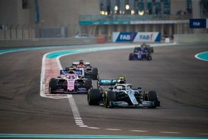 Valtteri Bottas, Mercedes AMG W10, leads Lance Stroll, Racing Point RP19, and Kimi Raikkonen, Alfa Romeo Racing C38