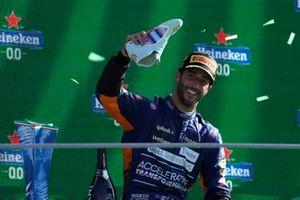 Daniel Ricciardo, McLaren, 1st position, finishes his shoey on the podium