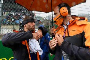 Daniel Ricciardo, McLaren, on the grid with engineers