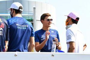 Nicholas Latifi, Williams, George Russell, Williams, and Daniel Ricciardo, McLaren, in the drivers parade