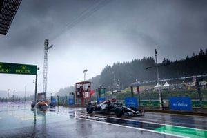 Lewis Hamilton, Mercedes W12, Daniel Ricciardo, McLaren MCL35M, in the pit lane