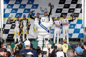 #4: Corvette Racing Corvette C8.R, GTLM: Tommy Milner, Nick Tandy, #3: Corvette Racing Corvette C8.R, GTLM: Antonio Garcia, Jordan Taylor, #79: WeatherTech Racing Porsche 911 RSR - 19, GTLM: Cooper MacNeil, Kevin Estre celebrate on the podium with The Michelin Man