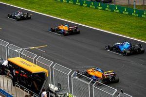 Lewis Hamilton, Mercedes W12, Lando Norris, McLaren MCL35M, George Russell, Williams FW43B, and Daniel Ricciardo, McLaren MCL35M, practice their start procedures at the end of FP2
