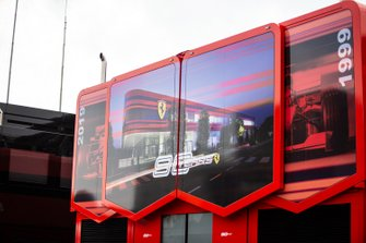 Ferrari Motorhome in the paddock with 90 Years branding