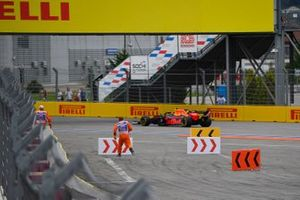 Marshals at work, as Alex Albon, Red Bull RB15, passes by