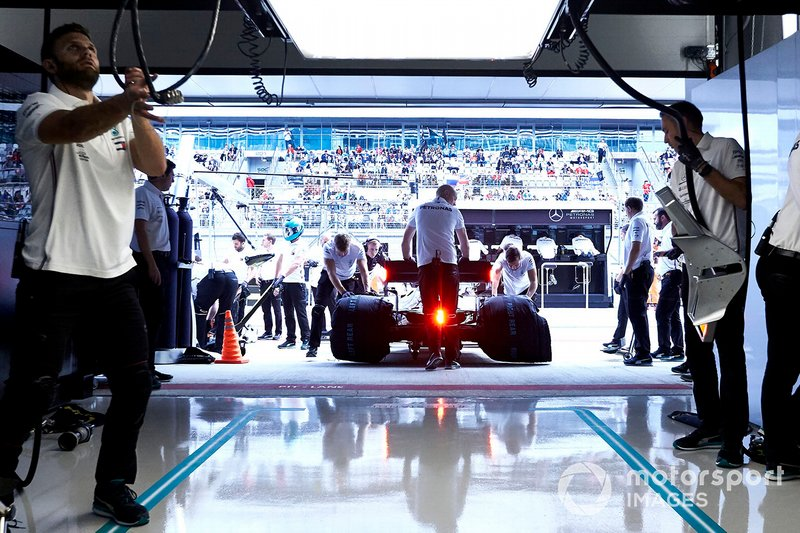 Lewis Hamilton, Mercedes AMG F1 W10, is returned to the garage