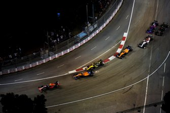 Carlos Sainz Jr., McLaren MCL34 and Nico Hulkenberg, Renault F1 Team R.S. 19 make contact