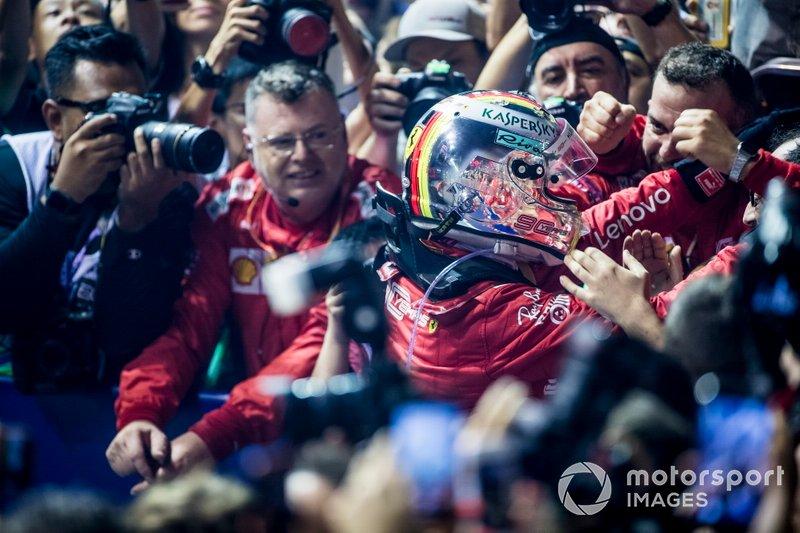 Race winner Sebastian Vettel, Ferrari, celebrates in Parc Ferme with his team