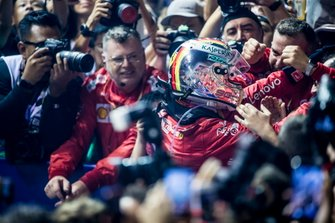 Race winner Sebastian Vettel, Ferrari, celebrates in Parc Ferme with his team