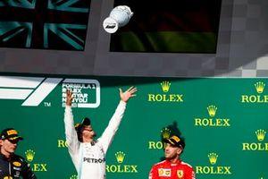 Max Verstappen, Red Bull Racing, Race winner Lewis Hamilton, Mercedes AMG F1 andSebastian Vettel, Ferrari n the podium with the trophy