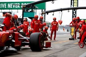 The Ferrari team stop one of their cars during practice.