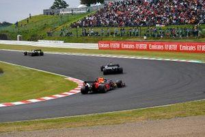 Nico Hulkenberg, Renault F1 Team R.S. 19, leads Romain Grosjean, Haas F1 Team VF-19, and Alex Albon, Red Bull RB15