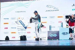 Sérgio Jimenez, 1st position, sprays champagne on the podium