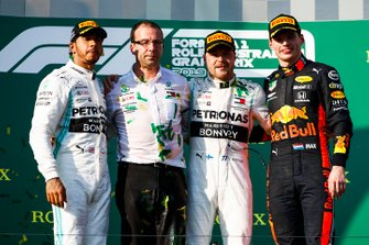 Lewis Hamilton, Mercedes AMG F1, 2nd position, the Mercedes Constructors trophy delegate, Valtteri Bottas, Mercedes AMG F1, 1st position, and Max Verstappen, Red Bull Racing, 3rd position, on the podium