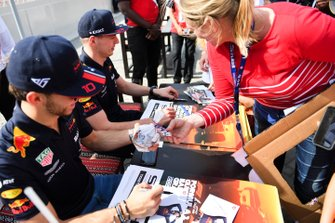 Pierre Gasly, Red Bull Racing, and Max Verstappen, Red Bull Racing, sign autographs for fans