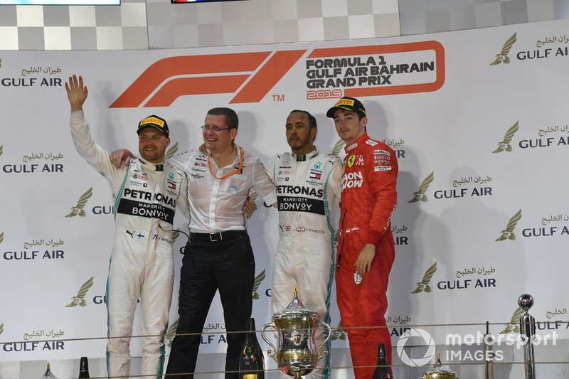 Valtteri Bottas, Mercedes AMG F1, 2nd position, Andy Cowell, Managing Director, HPP, Mercedes AMG, Lewis Hamilton, Mercedes AMG F1, 1st position, and Charles Leclerc, Ferrari, 3rd position, on the podium