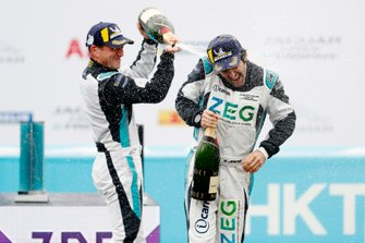 PRO class winner Bryan Sellers, Rahal Letterman Lanigan Racing sprays 3rd position Sérgio Jimenez, Jaguar Brazil Racing with champagne