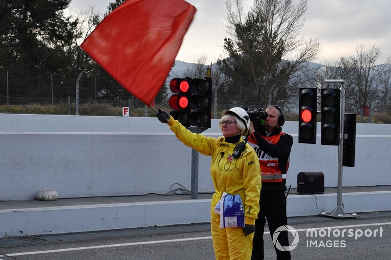 Marshal waves the red flag