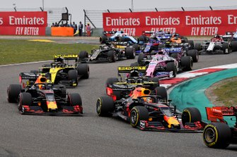 Sebastian Vettel, Ferrari SF90, leads Max Verstappen, Red Bull Racing RB15, Pierre Gasly, Red Bull Racing RB15, Daniel Ricciardo, Renault F1 Team R.S.19, Nico Hulkenberg, Renault F1 Team R.S. 19, Sergio Perez, Racing Point RP19, and the remainder of the field at the start