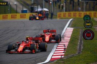Charles Leclerc, Ferrari SF90, leads Sebastian Vettel, Ferrari SF90, and Max Verstappen, Red Bull Racing RB15