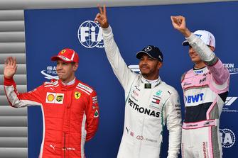 (L to R): Sebastian Vettel, Ferrari, Lewis Hamilton, Mercedes AMG F1 and Esteban Ocon, Racing Point Force India F1 Team celebrate in parc ferme