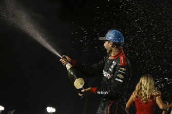 Will Power, Team Penske Chevrolet, celebrates with champagne