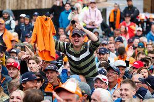 A Dutch fan holds up an orange shirt
