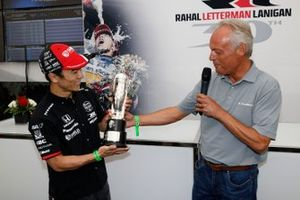 2020 Indy 500 winner Takuma Sato is presented with the Baby Borg-Warner Trophy by Fred Lissade, BorgWarner President and CEO