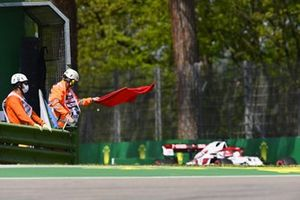 Marshals wave the red flag as Kimi Raikkonen, Alfa Romeo Racing C41, passes