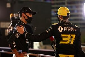 George Russell, Mercedes-AMG F1, with Esteban Ocon, Renault F1