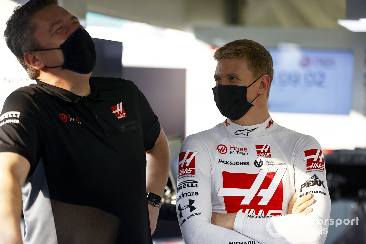 Mick Schumacher in the Haas garage with an engineer.