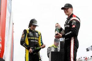 Josef Newgarden, Team Penske Chevrolet, Colton Herta, Andretti Autosport Honda, Simon Pagenaud, Team Penske Chevrolet celebrate with champagne in victory lane