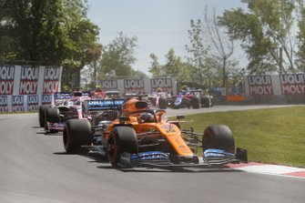 Carlos Sainz Jr., McLaren MCL34, leads Sergio Perez, Racing Point RP19