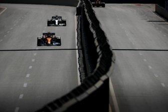 Lando Norris, McLaren MCL34, leads Lewis Hamilton, Mercedes AMG F1 W10