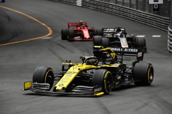 Nico Hulkenberg, Renault R.S. 19, leads Romain Grosjean, Haas F1 Team VF-19, and Charles Leclerc, Ferrari SF90