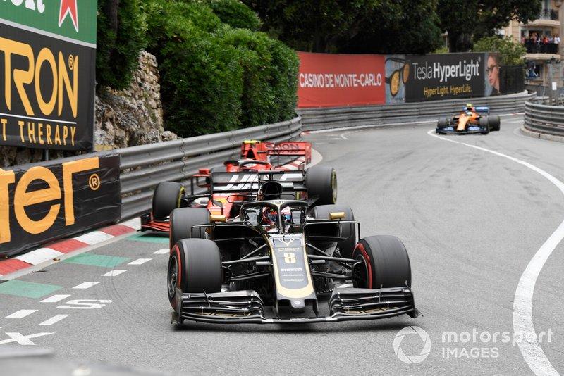 Romain Grosjean, Haas F1 Team VF-19, leads Charles Leclerc, Ferrari SF90
