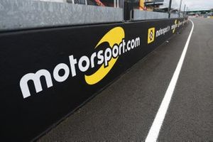 Motorsport.com and Motorsport.tv signage on the front straight