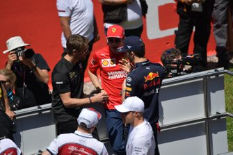 Romain Grosjean, Haas F1, Charles Leclerc, Ferrari, and Pierre Gasly, Red Bull Racing, talk at the drivers parade