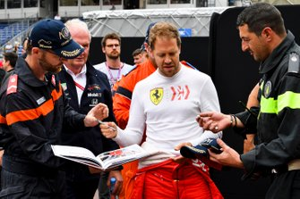 Sebastian Vettel, Ferrari, signs some autographs for marshals