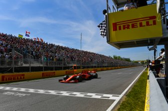 Sebastian Vettel, Ferrari SF90, 2nd position, crosses the line first