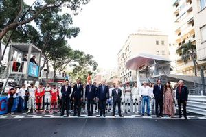 Drivers stand on the start line for the Monegasque national anthem