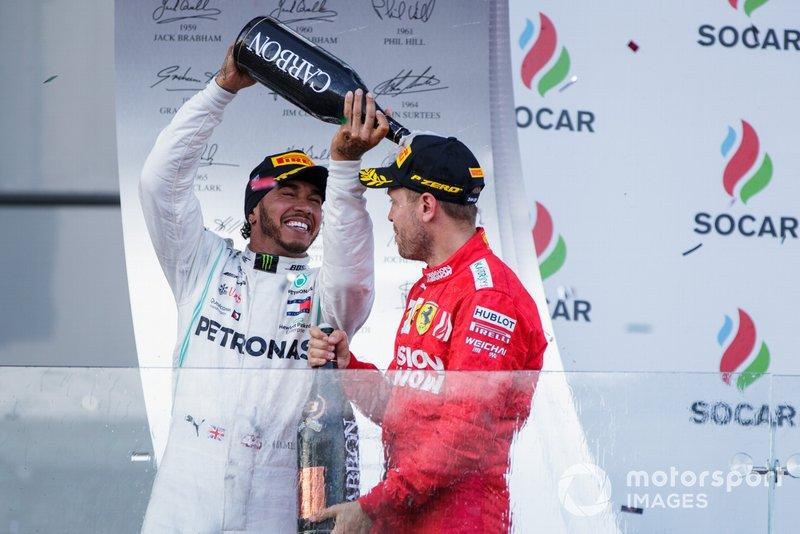 Lewis Hamilton, Mercedes AMG F1, 2nd position, pours Champagne over Sebastian Vettel, Ferrari, 3rd position