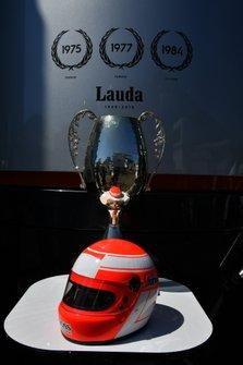Niki Lauda helmet and trophy display in the paddock