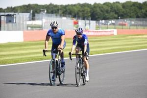 Valtteri Bottas, Mercedes-AMG Petronas F1 and Tiffany Cromwell cycle the track