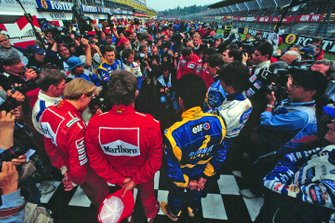 The drivers stand on the grid, in remembrance a year after the deaths of Ayrton Senna and Roland Ratzenberger