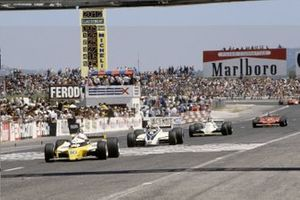 Rene Arnoux, Renault RE20 leads Nelson Piquet, Brabham BT49-Ford Cosworth, Carlos Reutemann, Williams FW07B-Ford Cosworth and Gilles Villeneuve, Ferrari 312T5