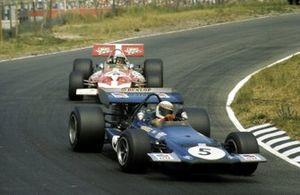 Jackie Stewart, Tyrrell Racing Organisation March 701 leads John Surtees, Team Surtees McLaren M7A