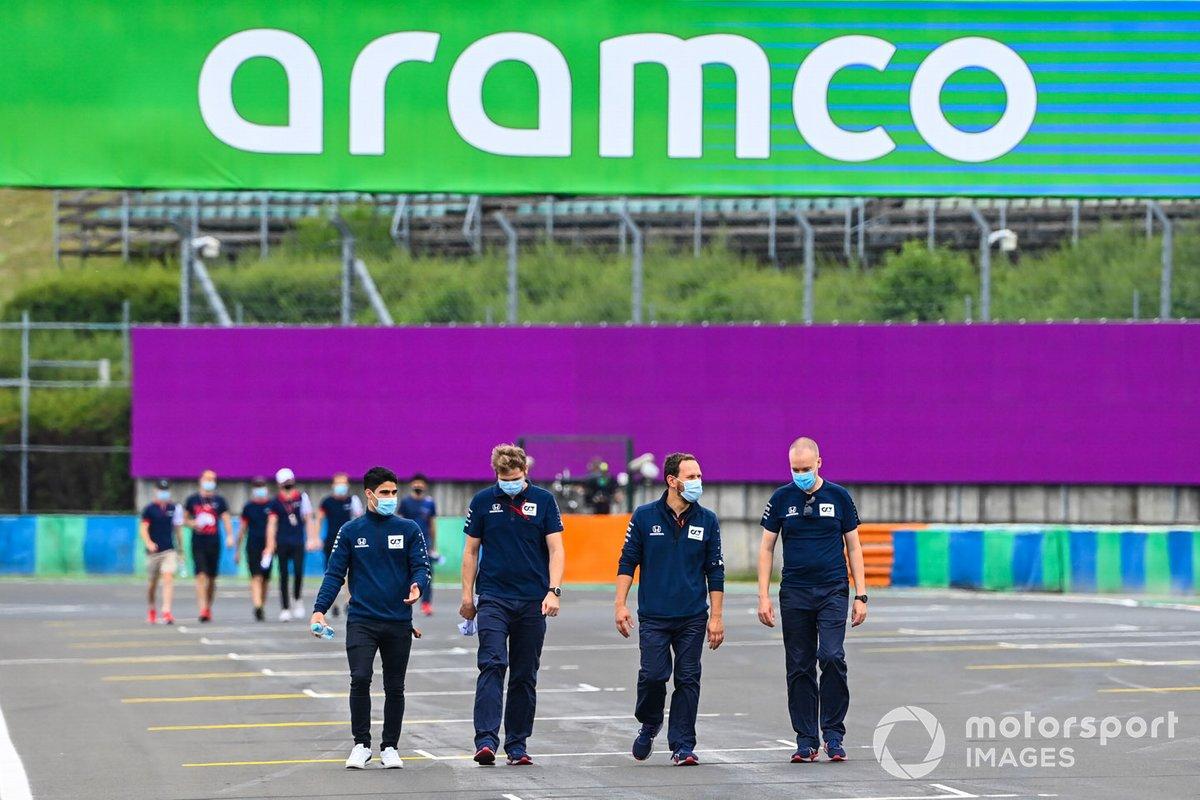Sergio Sette Camara walks the track with team members
