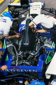 Engineers work on Jean Alesi's Benetton B196