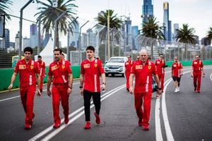 Charles Leclerc, Ferrari walks the track with members of the team including Jock Clear, Race Engineer, Ferrari.